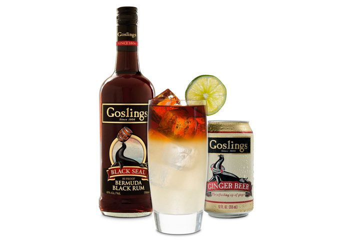 A Dark-'N-Stormy in front of a bottle of Gosling's Black Seal rum and a can of Gosling's ginger beer