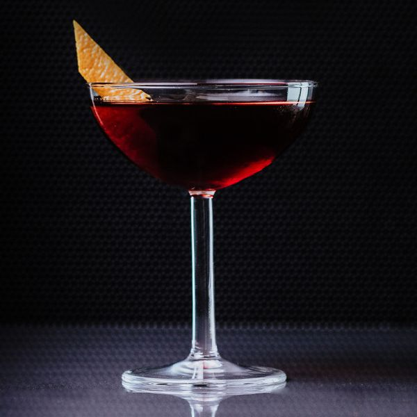 martinez cocktail in a coupe with an orange peel garnish
