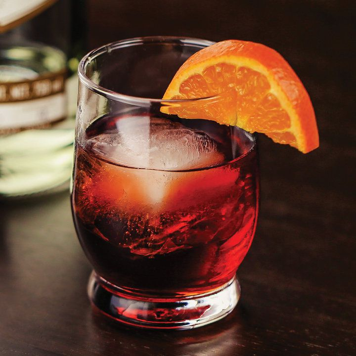 Mezcal Negroni in a rocks glass with an orange garnish