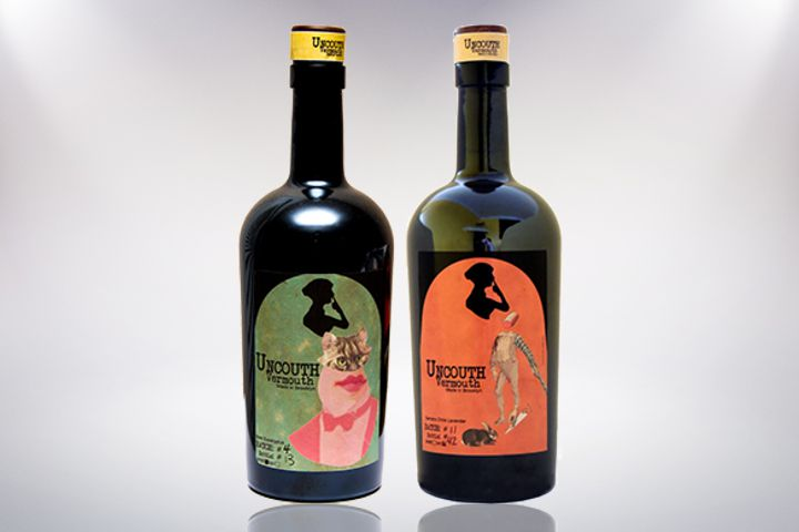 Two bottles of Uncouth Vermouth pictured side by side against a white background