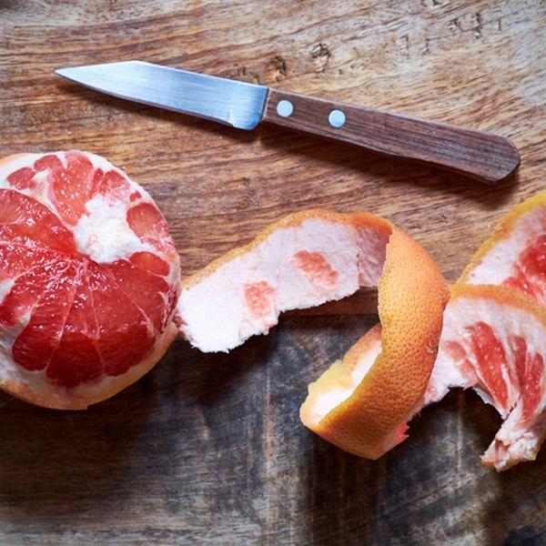 Peeled Pink Grapefruit and Paring Knife