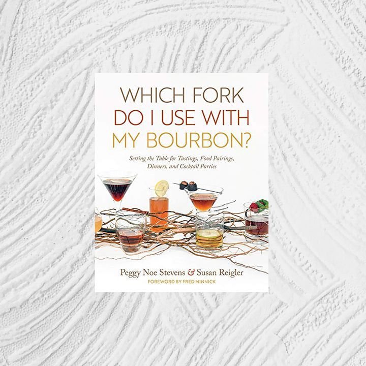 Which Fork Do I Use with My Bourbon? cover, white background with multicolored title text above a tablescape made up of dried branches and various cocktails