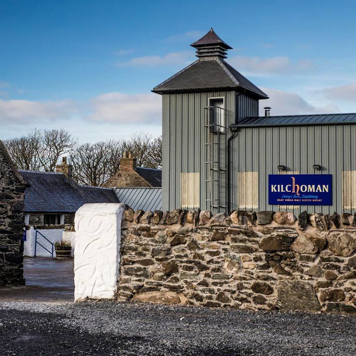 Kilchoman Distillery with the edge of the property's brick wall