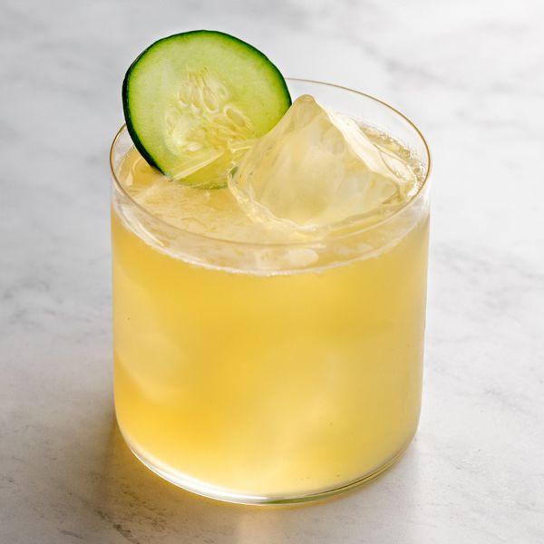 Irish Maid cocktail on the rocks with a cucumber garnish