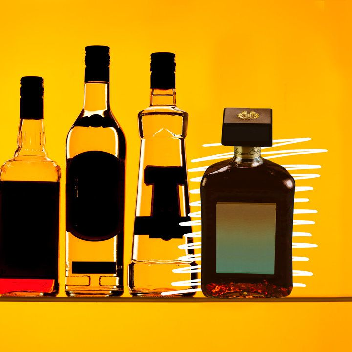 Photo illustration of four various liquor bottles with their labels blacked out, one of which is emphasized with white hand-drawn lines on the far right of the lineup.