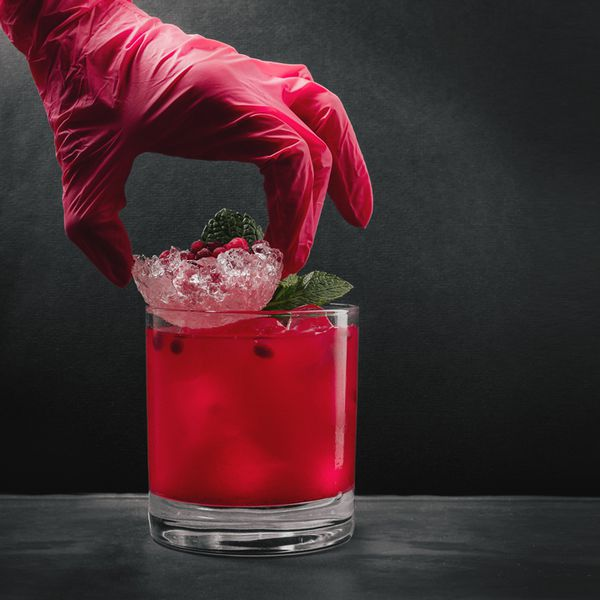 Drink with hand in glove