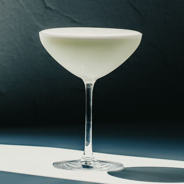White Lady cocktail in a coupe glass against a dark background