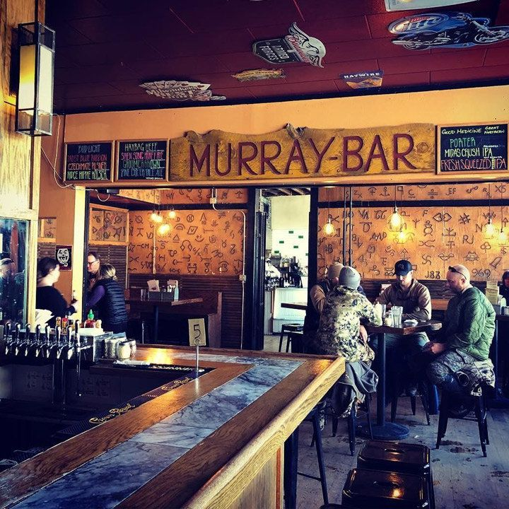 murray bar in montana. the walls have cattle-branding iconography