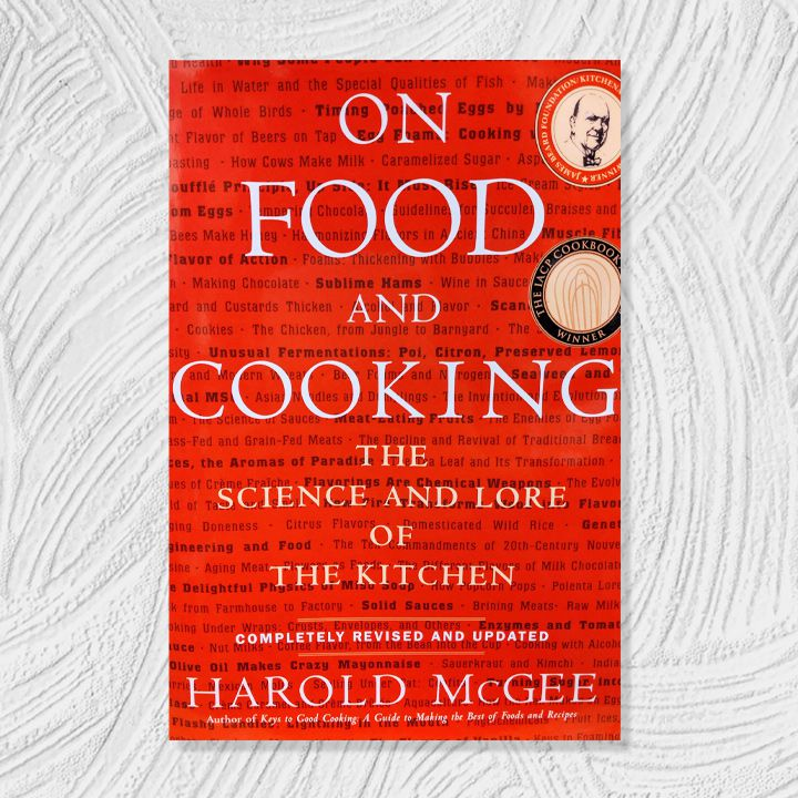 On Food and Cooking cover, bright red background with small black decorative text and white cover text overlaid