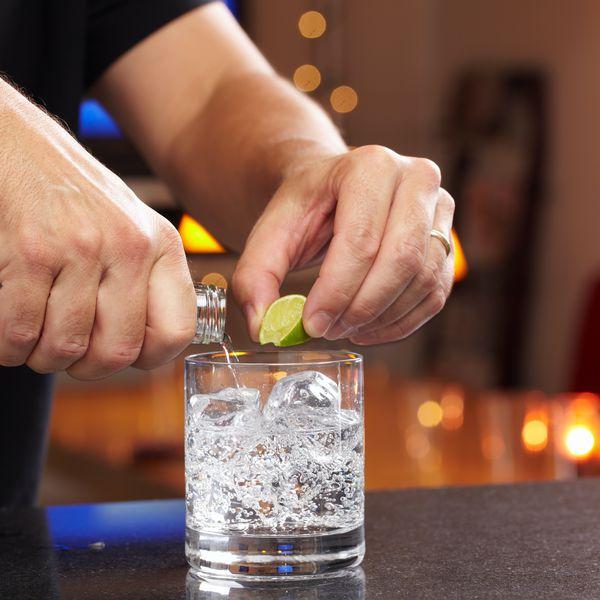 pouring vodka in rocks glass