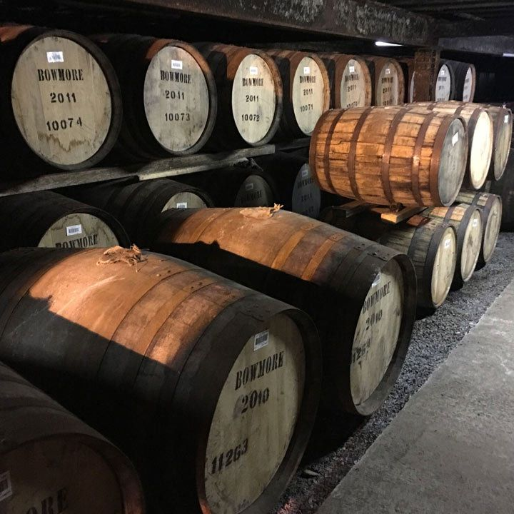 Bowmore Distillery and a few barrels in its storehouses