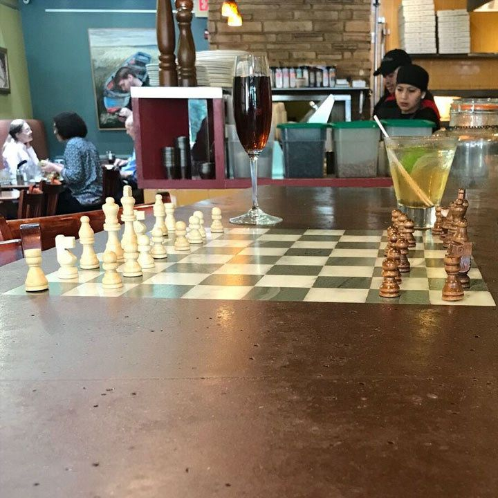 The Daily Dish interior view of bar top with chess board