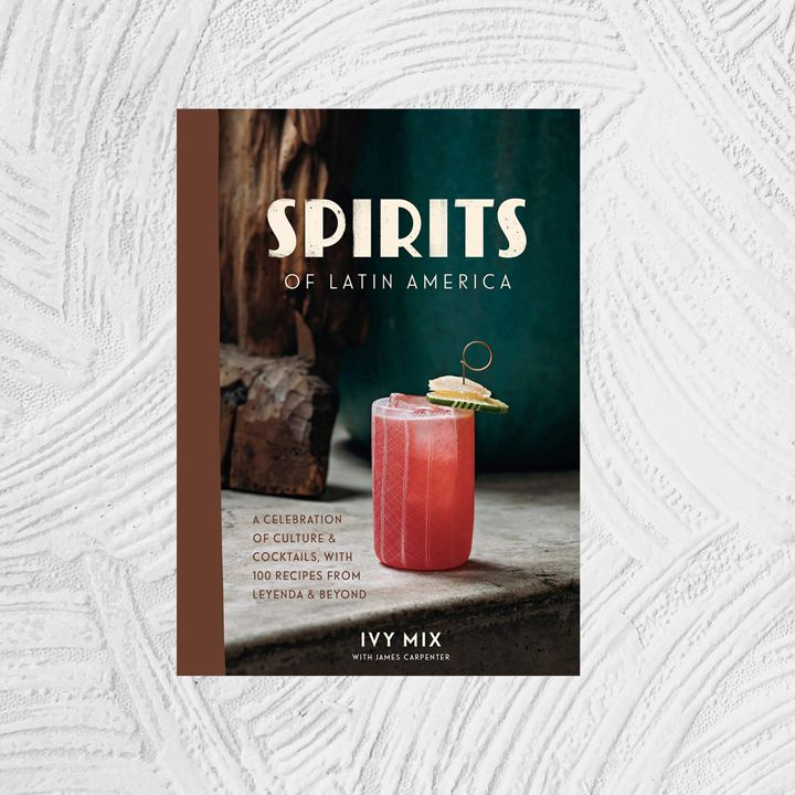 Spirits of Latin America cover with brown binding and an image of a cocktail in a Latin-American tabletop setting with natural textures and a dark teal vase