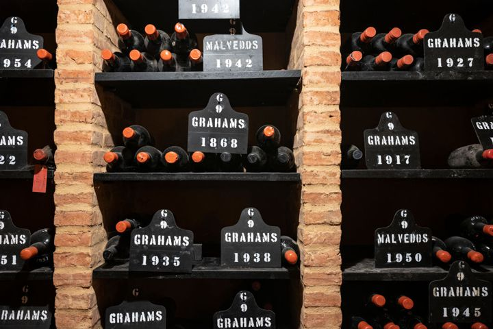 Rows of Graham's cellared port bottles with brick dividers