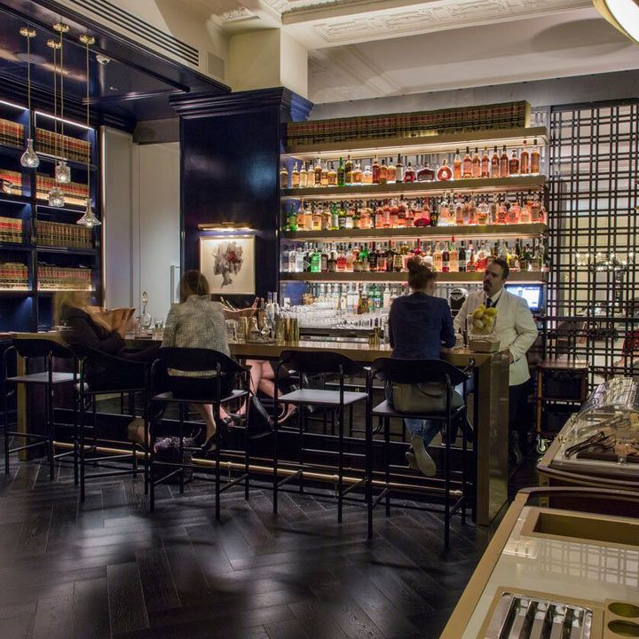 Vol. 39 bar interior, featuring a latticed wall ear the bar and a mix of white and navy color palette