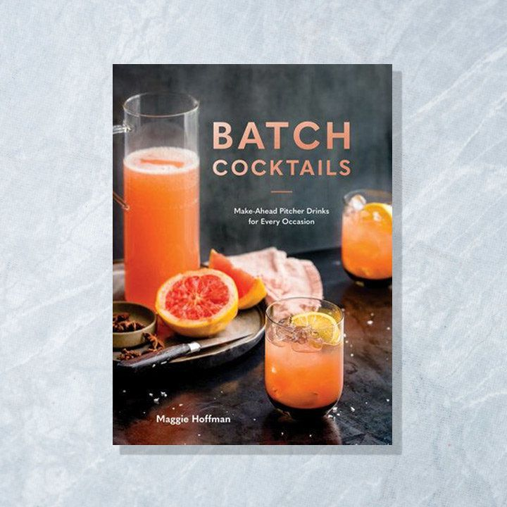 Batch Cocktails cover featuring a tall glass pitcher and two rocks glasses filled with a pink-orange colored cocktail along with sliced citrus and and spices scattered around