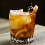 Wisconsin Old Fashioned garnished with an orange slice and brandied cherry