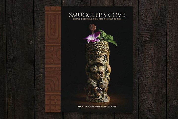 Smuggler's Cove book cover featuring a dramatic photograph of an intricately carved tiki mug garnished with a Karma orchid and mint sprig
