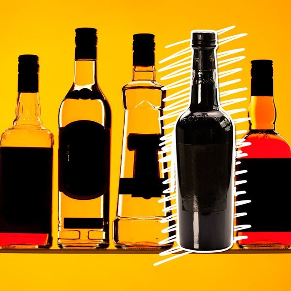 Photo illustration of various bottles with blacked-out labels against an orange background with a white scribble emphasizing a Port bottle