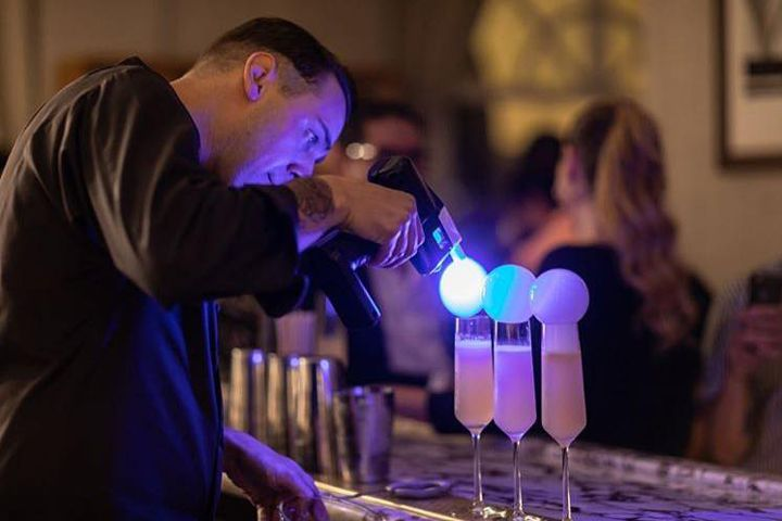A bartender using the Flavour Blaster