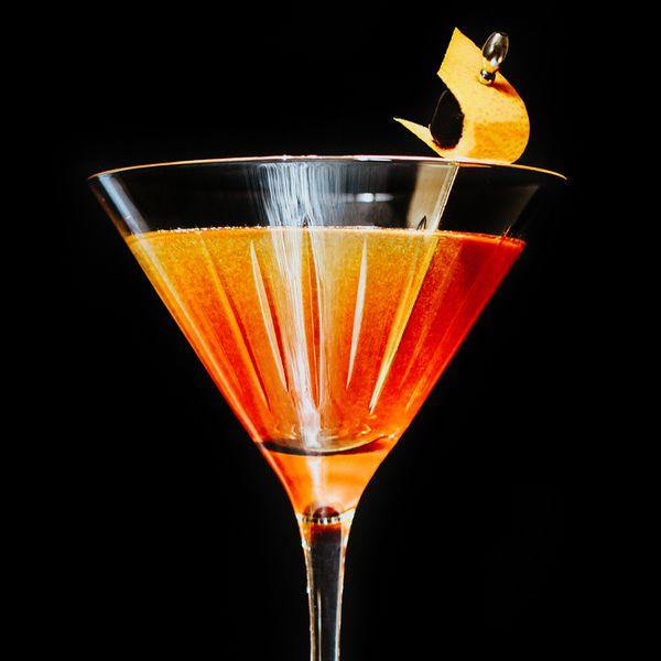 Man o' War cocktail with lemon peel and cherry garnish