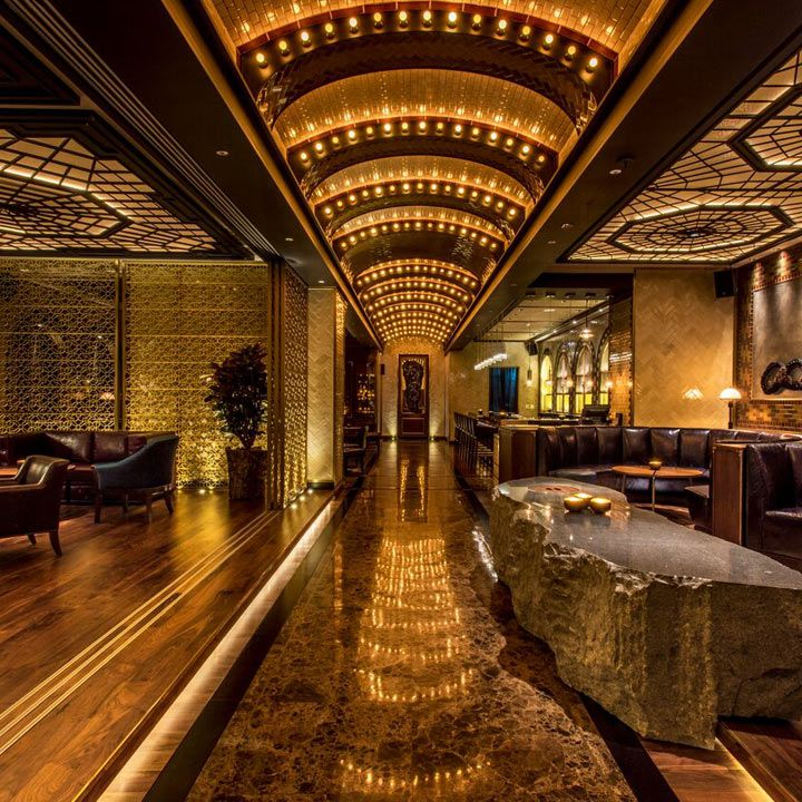 Charles H bar interior. Sleek and modern with dark colors and moody lighting