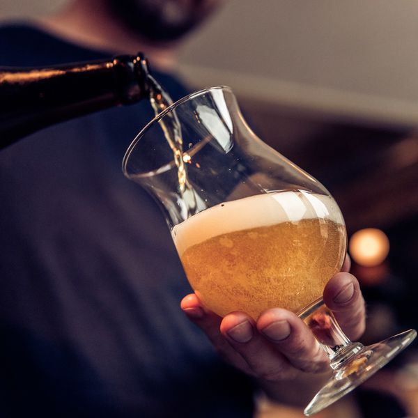 pouring beer from bottle to glass