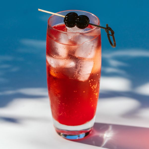 shirley temple drink garnished with two skewered cherries