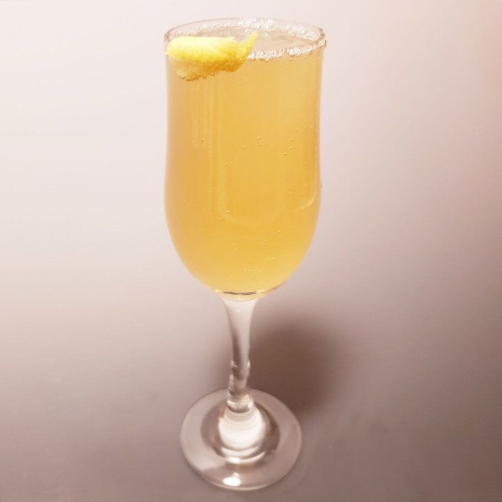 French Harvest cocktail in champagne flute with lemon peel garnish