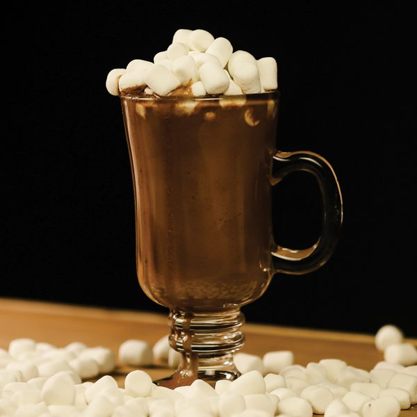 boozy hot chocolate cocktail in a glass mug with mini marshmallows