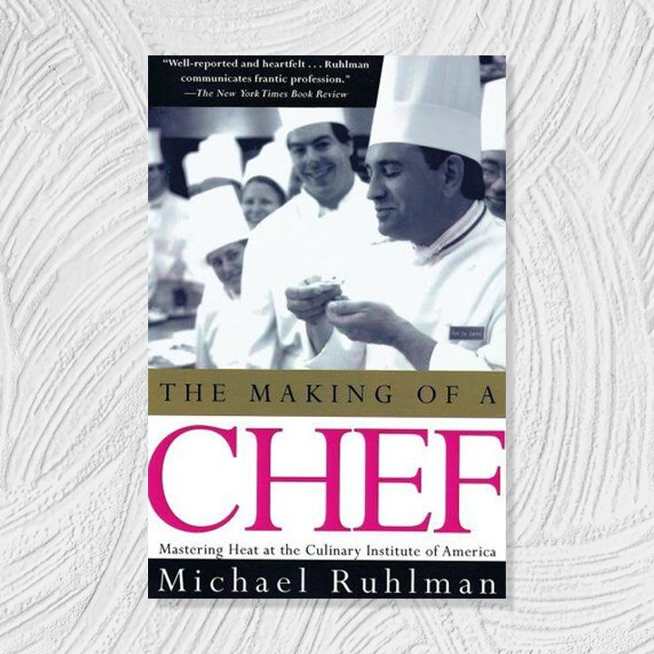The Making of a Chef cover with a black and white photo of chefs above a gold, black, white, and magenta text block