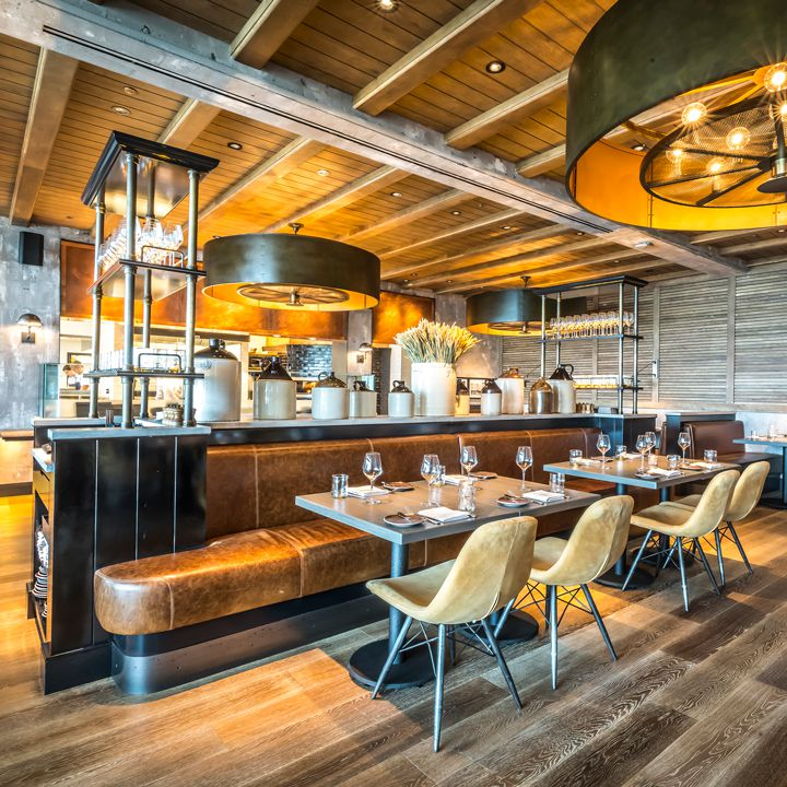 Rye Street Tavern at Sagamore Spirit in Baltimore. Modern fixtures and a brown, taupe and silver palette