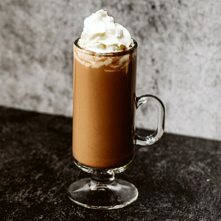 Rumplesnuggler cocktail in Irish Coffee mug topped with whipped cream