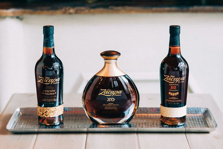 Three Ron Zacapa bottles lined up on a silver tray