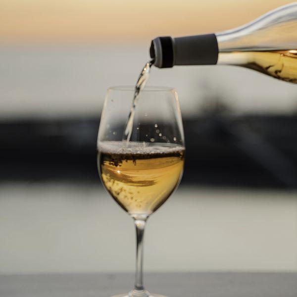 pouring orange wine sunset