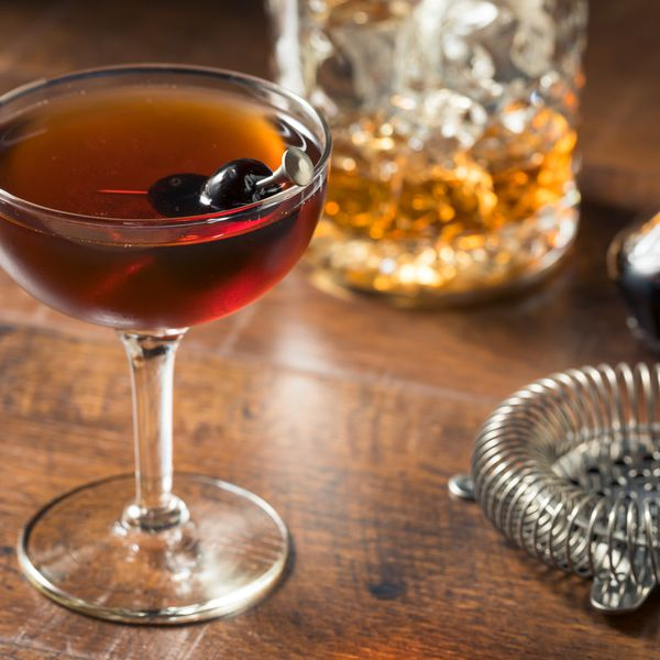 Manhattan in coupe glass with cherries
