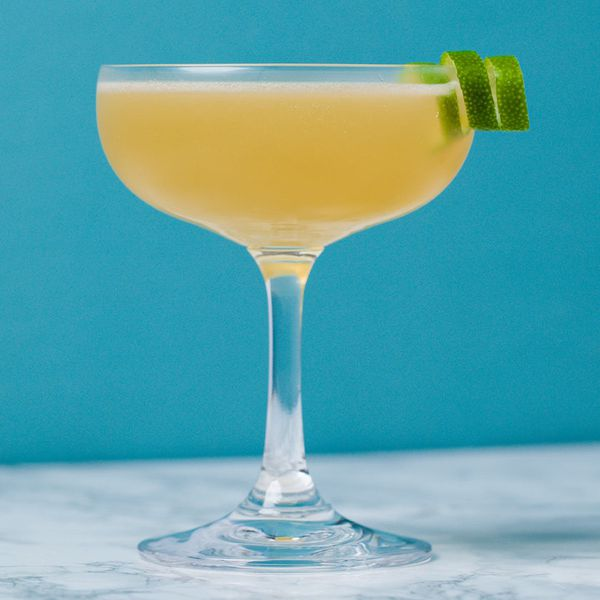 daiquiri cocktail in a coupe with a lime twist garnish