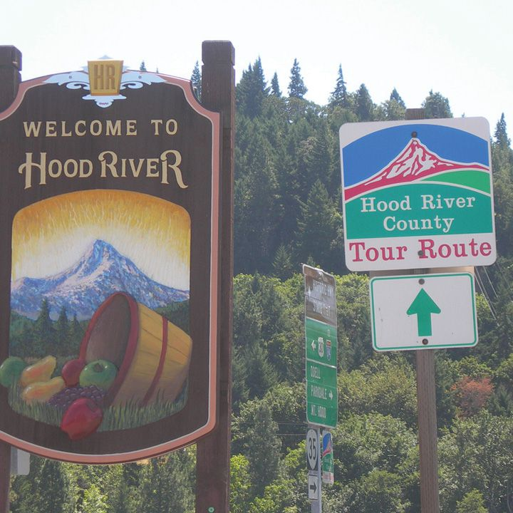 hood river signs including a welcome sign and a Tour Route sign