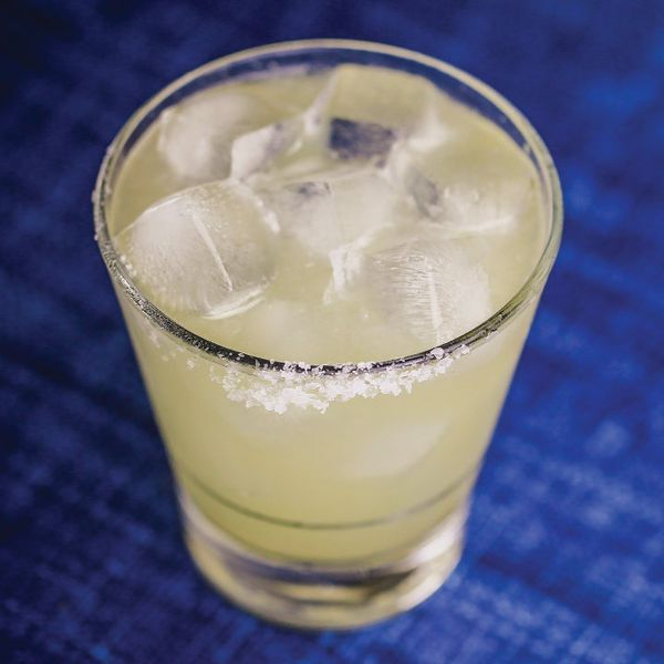 Tommy's Margarita in salt-rimmed glass on blue surface