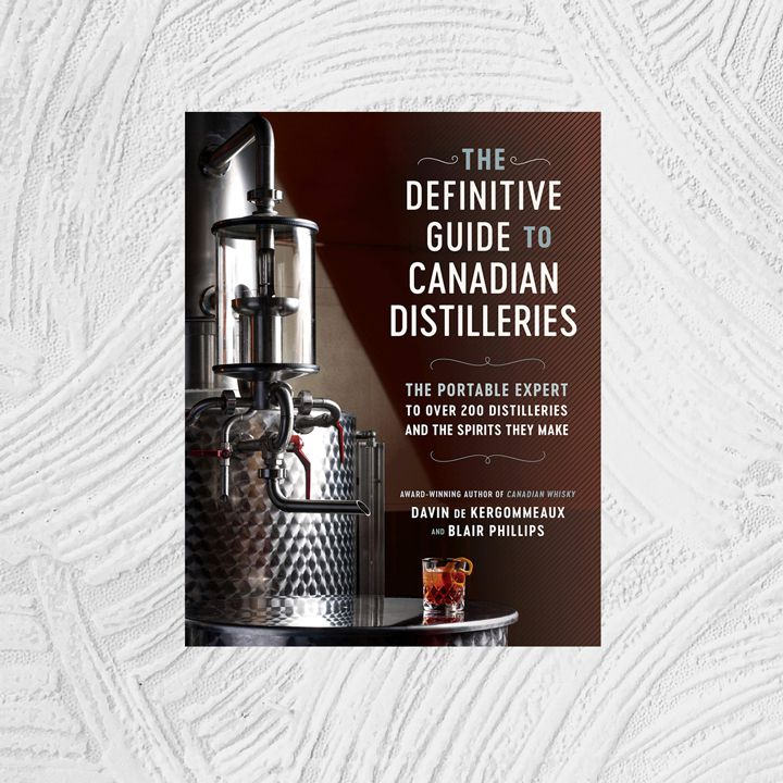 The Definitive Guide to Canadian Distilleries: The Portable Expert to Over 200 Distilleries and the Spirits they Make (from Absinthe to Whisky, and Everything in Between) cover in dark brown with an image of a still and a red cocktail next to a right-aligned sans serif text block