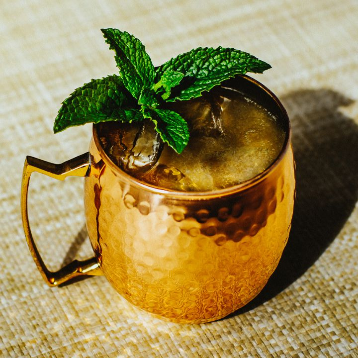 Kentucky Mule cocktail in a copper mug with a mint garnish