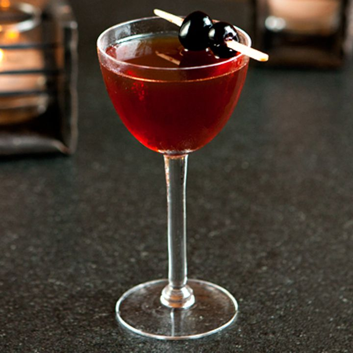 rob roy cocktail garnished with two skewered cherries
