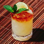 Mai Tai cocktail with a dark rum float, mint sprig and lime wheel