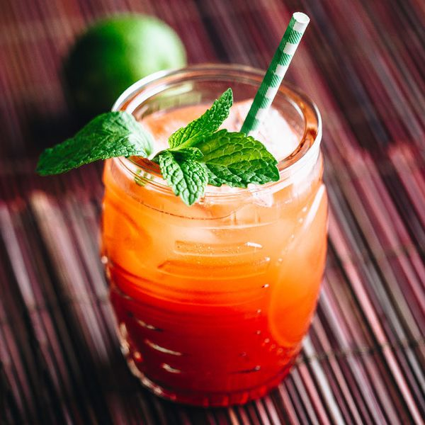 planter's punch cocktail with mint garnish and green-and-white-striped straw