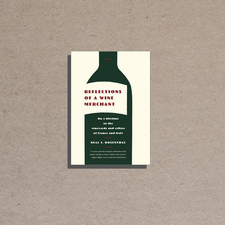 Reflections of a Wine Merchant cover, off white background and offset label on a large solid dark green vertical wine bottle containing burgundy and white text