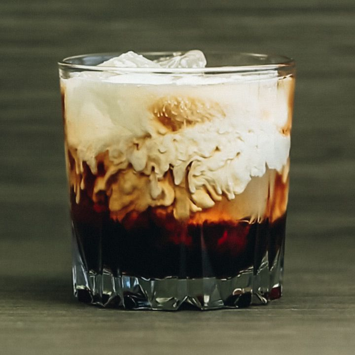 A close-up of a White Russian in a beveled rocks glass