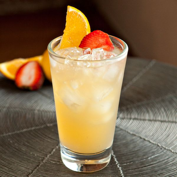 Boston Rum Punch garnished with an orange slice and strawberry