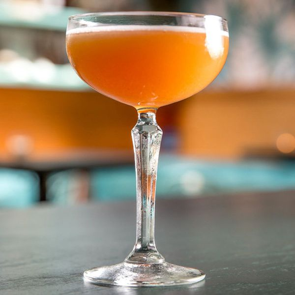 orange-hued Fall from the Tree cocktail in a coupe glass