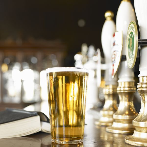 Book and beer on bar
