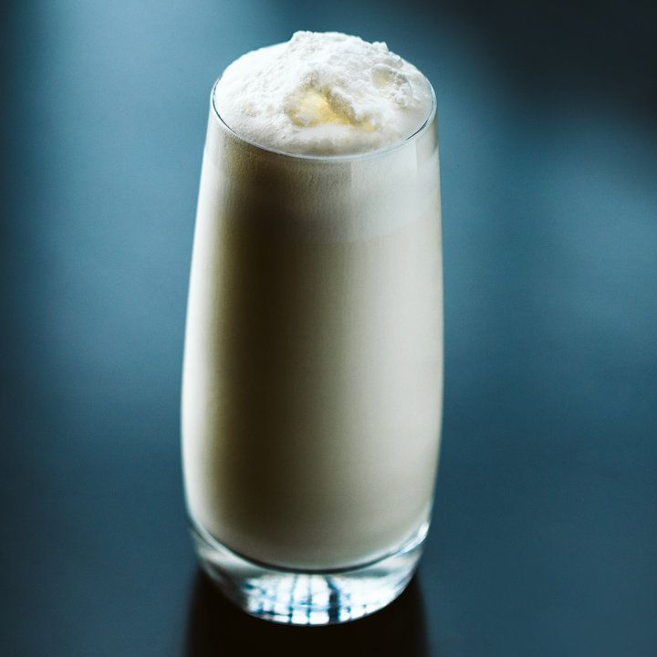 ramos gin fizz cocktail with a thick frothy head served in a Collins glass